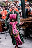 A girl dances traditional dance accompanied by angklung music stock photos