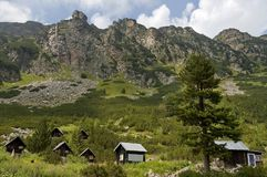 Maliovitza peak and the rest-house Maliovitza in Rila Stock Image