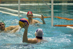 Malkov T. (8) atack the Sintez team. MOSCOW - APRIL 6: Taras Malkov during a game Dynamo(white) vs Sintez (green) of waterpolo Championship of Russia on April 6 Royalty Free Stock Images