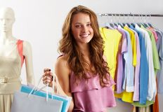In the mall. Portrait of a girl with paper bags in clothing departmant Stock Image