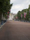 The Mall avenue and Queen Victoria Memorial, London. The Queen Victoria Memorial at the end of Mall avenue and in front of Buckingham palace, London UK Royalty Free Stock Photography