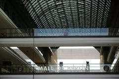 Mall of Berlin. Berlin, Germany - June 21, 2016: Guests and visitors go over two bridges with Glass railings in the Mall of Berlin on June 21, 2016 in Berlin Royalty Free Stock Images