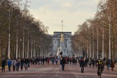 The Mall Buckingham Palace London. Crowds of people at The Mall with Buckingham Palace , London,  in the distance.  Picture taken on early morning winter Sunday Royalty Free Stock Images