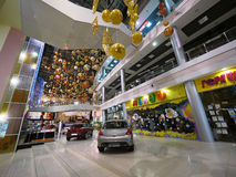 Mall with cars. New Year. Christmas decorations. Beautifully decorated building in the New year. Moscow, Russia - November 29, 2010: Mall with cars. New Year Royalty Free Stock Photo