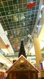 Mall Christmas celebrations. With Santa Workshop and tree Stock Photography