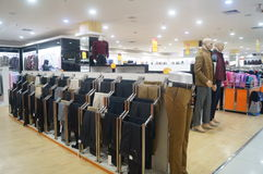 Mall clothing sales. Clothing sales shopping malls in Shenzhen street manhole, China Royalty Free Stock Photo