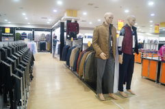 Mall clothing sales. Clothing sales shopping malls in Shenzhen street manhole, China Stock Photo