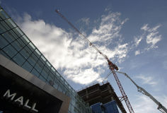 Mall Construction Site. Crane and concrete pump on a new Mall construction site in Sofia, Bulgaria Stock Image