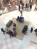 Mall crowd. People shopping and hanging out at a mall Stock Photos