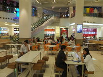 Mall of the Emirates in Dubai, UAE. Food Court in Mall of the Emirates in Dubai, UAE. It is the world's first shopping resort and a multi-level shopping centre Royalty Free Stock Images