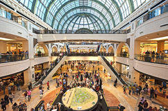 Mall of the Emirates. Dubai, UAE - January 01, 2015: The locals and tourist walking and buying in the Mall of the Emirates Royalty Free Stock Photography