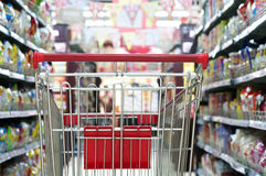 The mall is a empty shopping cart. Supermarket interior, empty red shopping cart Stock Photography