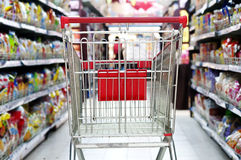 The mall is a empty shopping cart. Supermarket interior, empty red shopping cart Stock Photo