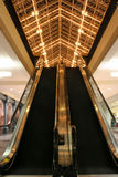 Mall Escalator. A moving escalator in a shopping mall stock photography