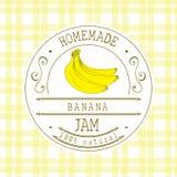 Mall för driftstoppetikettdesign för bananefterrättprodukt med den drog handen skissade frukt och bakgrund Illustra för klotterve Arkivfoton