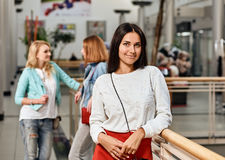 Mall Girl portrait. Three pretty girls having fun while shopping - Best female friends spending time together. one women portrait with two on background Royalty Free Stock Photo