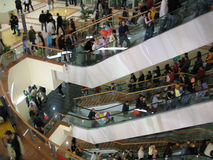 Mall interior. With elevators and mass of people Royalty Free Stock Images