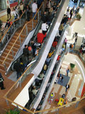 Mall interior. With elevators and mass of people Stock Images