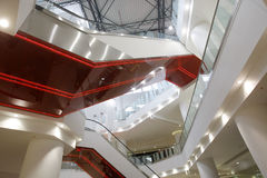 Mall interior. Shopping mall with multilevel escalators Stock Photos