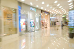 Mall interior. Blurred motion image Royalty Free Stock Photos
