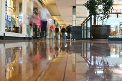 Mall Journey. Journey to the mall - a blur of shoppers searching for the best buy Royalty Free Stock Image