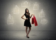 Mall lady with drawn shopping bags on wall Stock Images