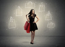 Mall lady with drawn shopping bags on wall Royalty Free Stock Image