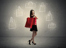 Mall lady with drawn shopping bags on wall Stock Photography