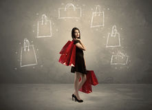Mall lady with drawn shopping bags on wall Royalty Free Stock Photos