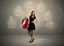 Mall lady with drawn shopping bags on wall Stock Photo