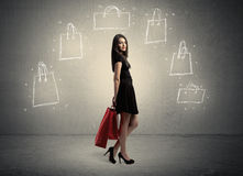 Mall lady with drawn shopping bags on wall Royalty Free Stock Photo