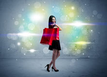 Mall lady with shopping bags and glitter light Royalty Free Stock Photo