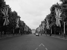 Mall in London black and white. LONDON, UK - CIRCA JUNE 2017: The Mall links Trafalgar Square to Buckingham Palace in black and white Royalty Free Stock Photography