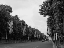 Mall in London black and white. LONDON, UK - CIRCA JUNE 2017: The Mall links Trafalgar Square to Buckingham Palace in black and white Royalty Free Stock Photos