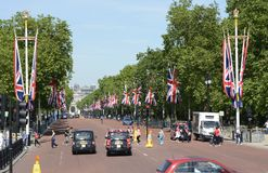 The Mall. London. England. View down The Mall towards Horse Guards Parade from The Queen Victoria Memorial at Buckingham Palace. With traffic and tourists Royalty Free Stock Images