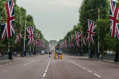 The Mall. London, UK. The Mall in London lined with british flags Union Jack flags the day before of the british marathon Stock Photos