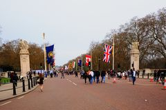 The Mall in London lined with commonwealth flags. The Mall, London, England, 2018. The Mall in London leading to Buckingham Palace with Commonwealth Flags flying Royalty Free Stock Photos