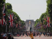 The Mall in London. LONDON, UK - CIRCA JUNE 2018: Union Jack flags on the Mall for the celebration of the Queen birthday with Buckingham Palace in the background Stock Photos