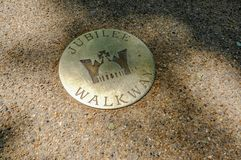 Brass plaque on the Mall of the Queens Jubilee. The Mall, London, UK - June 8, 2018: brass plaque commemorating Queen Elizabeth`s Jubilee. Anniversary of her royalty free stock photos