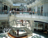 Mall at Millenia staircase. Interior of luxury Mall at Millenia, Orlando, Florida, stairs from the 2nd floor balcony down to the first floor.  Shoppers visible Royalty Free Stock Photography