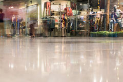 Mall in motion. People walking in the mall, long exposure, photograph taken from the floor giving a low-angle view and the shopping are blurred Stock Image