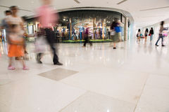 Mall in motion. People walking in the mall, long exposure, photograph taken from the floor giving a low-angle view and the shopping are blurred Royalty Free Stock Photo
