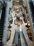 The mall. Picture taken in shoping mall. You can see the panoramic view of electric stairs and many commercial stands Stock Images