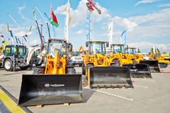 MAll-purpose wheel loaders of AMKODOR. MOSCOW - MAY 29: All-purpose wheel loaders of AMKODOR at 13th International Specialized Exhibition CET 2012 at the Stock Photos