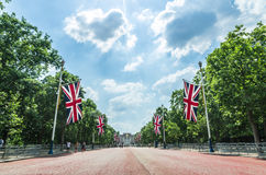 Tourists on The Mall walking southwest towards Buckingham Palace in London. The Mall is a road in the City of Westminster, central London, between Buckingham Royalty Free Stock Images