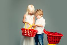 Mall shopping. Buy products. Play shop game. Cute buyer customer client hold shopping cart. Girl and boy children stock photo