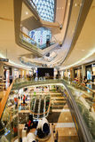 Mall shopping mall interior. SHENZHEN, CHINA - OCTOBER 15, 2015: KK Mall shopping mall interior. KK Mall is high-end shopping mall in Shenzhen, within walking Royalty Free Stock Photography