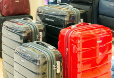 Mall suitcase. Sale of suitcases of different sizes and colors Royalty Free Stock Photo