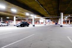 Mall underground parking. Underground parking garage, with a few cars Stock Photography