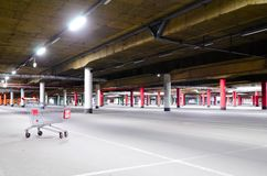Mall underground parking. Shopping mall underground parking garage, without any cars Royalty Free Stock Images